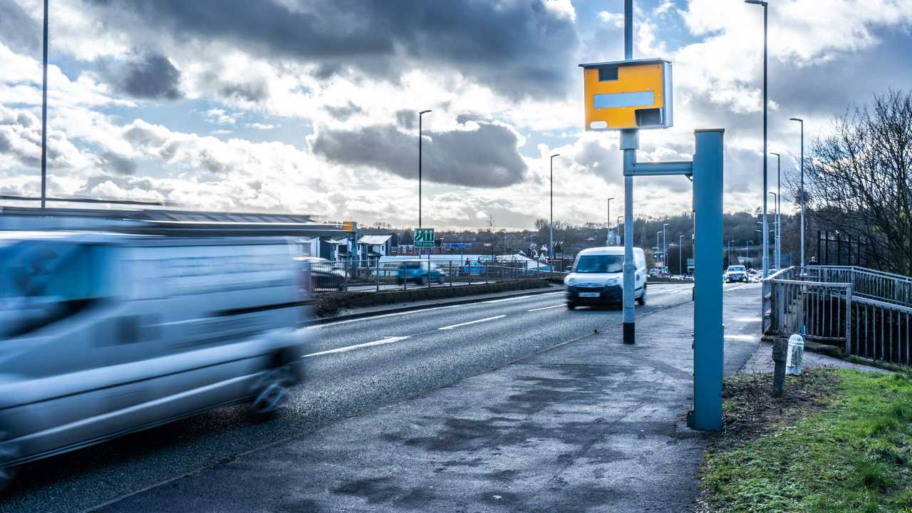 Cars travel past a speed camera in Stoke on Trent UK