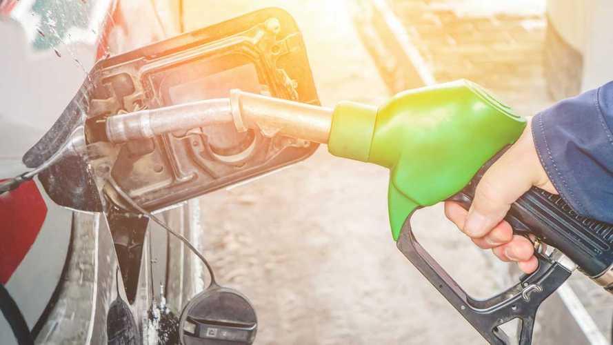 Man fills petrol tank of car