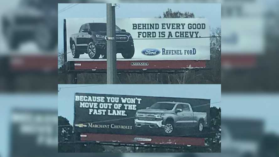 Ford And Chevy Dealers Duke It Out In Billboard Battle