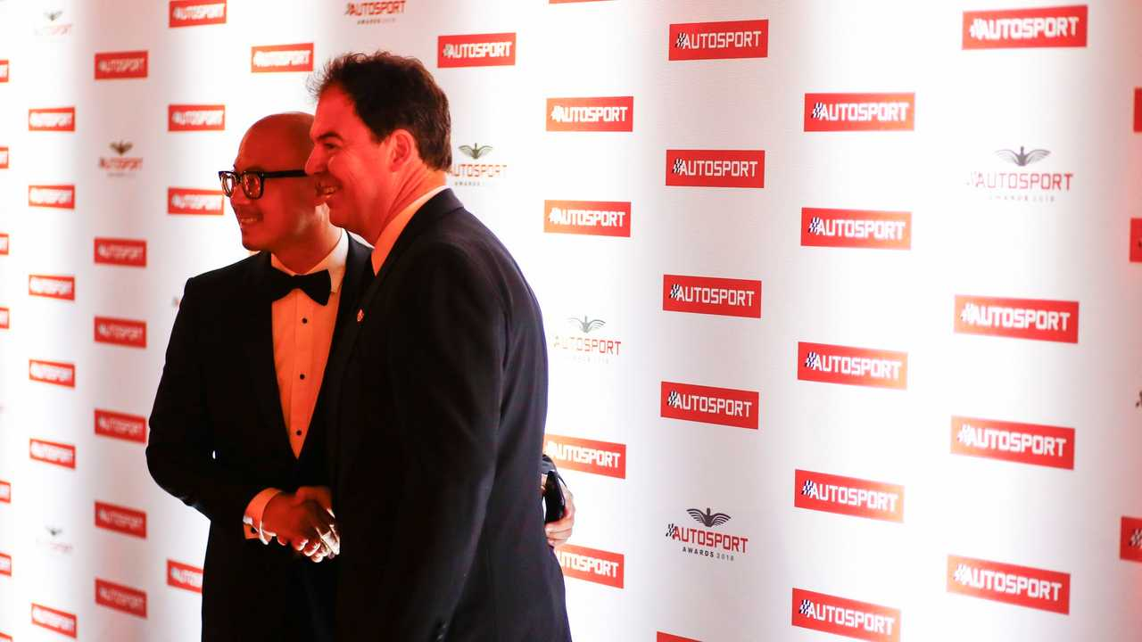 Edmund Chu and James Allen shake hands on the deal at Sunday's Autosport Awards at the Grosvenor House Hotel on Park Lane in London