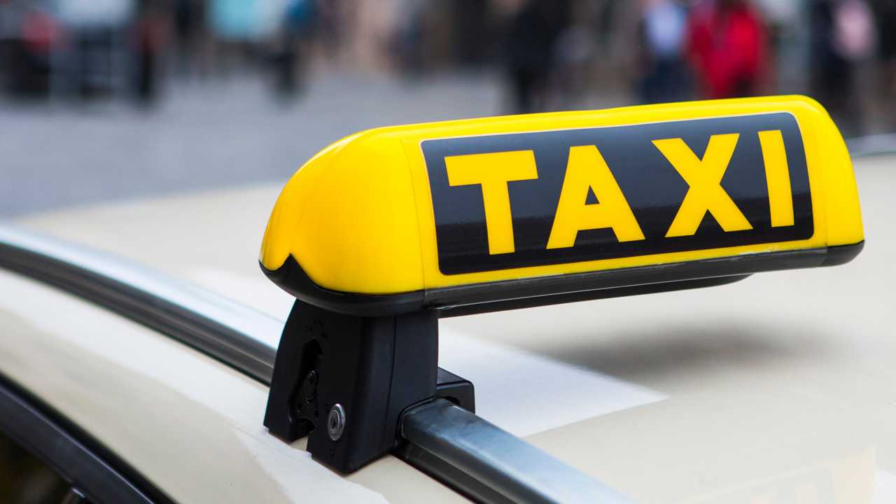 Taxi sign mounted on car roof