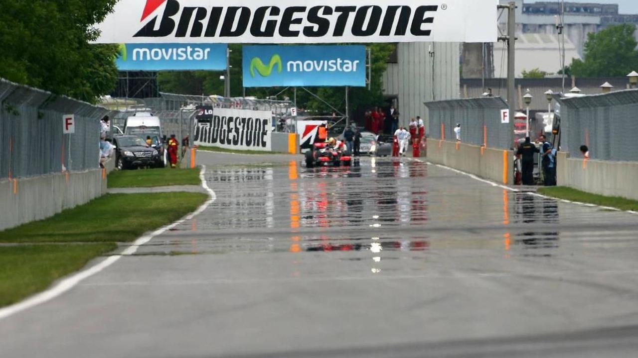 Lewis Hamilton (GBR), McLaren Mercedes push his car after qualifying, Canadian Grand Prix, Saturday Qualifying, 12.06.2010 Montreal, Canada