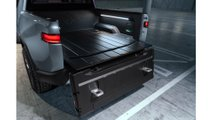 K. Rivian R1T_Tailgate_180_Open_Steps_Out