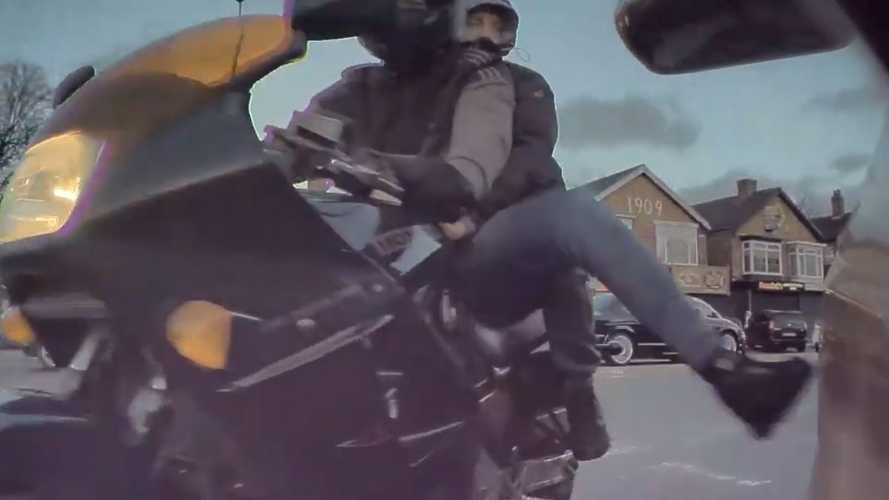 Watch This Motorcyclist Chase Down A Tesla Just To Kick It