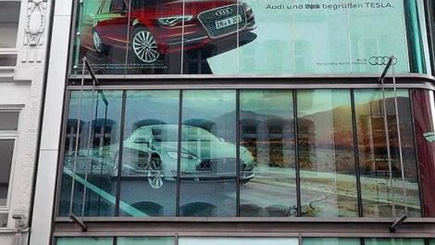 Audi welcomes Tesla in Hamburg through a billboard