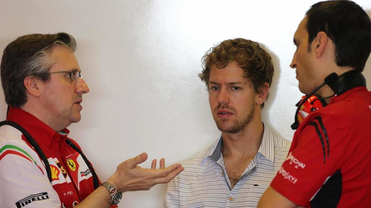 Pat Fry (GBR), Scuderia Ferrari, Technical Director and Sebastian Vettel (GER) / XPB