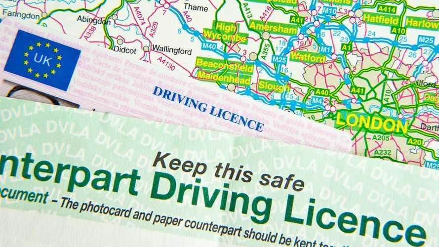 UK driving license on UK road map around London