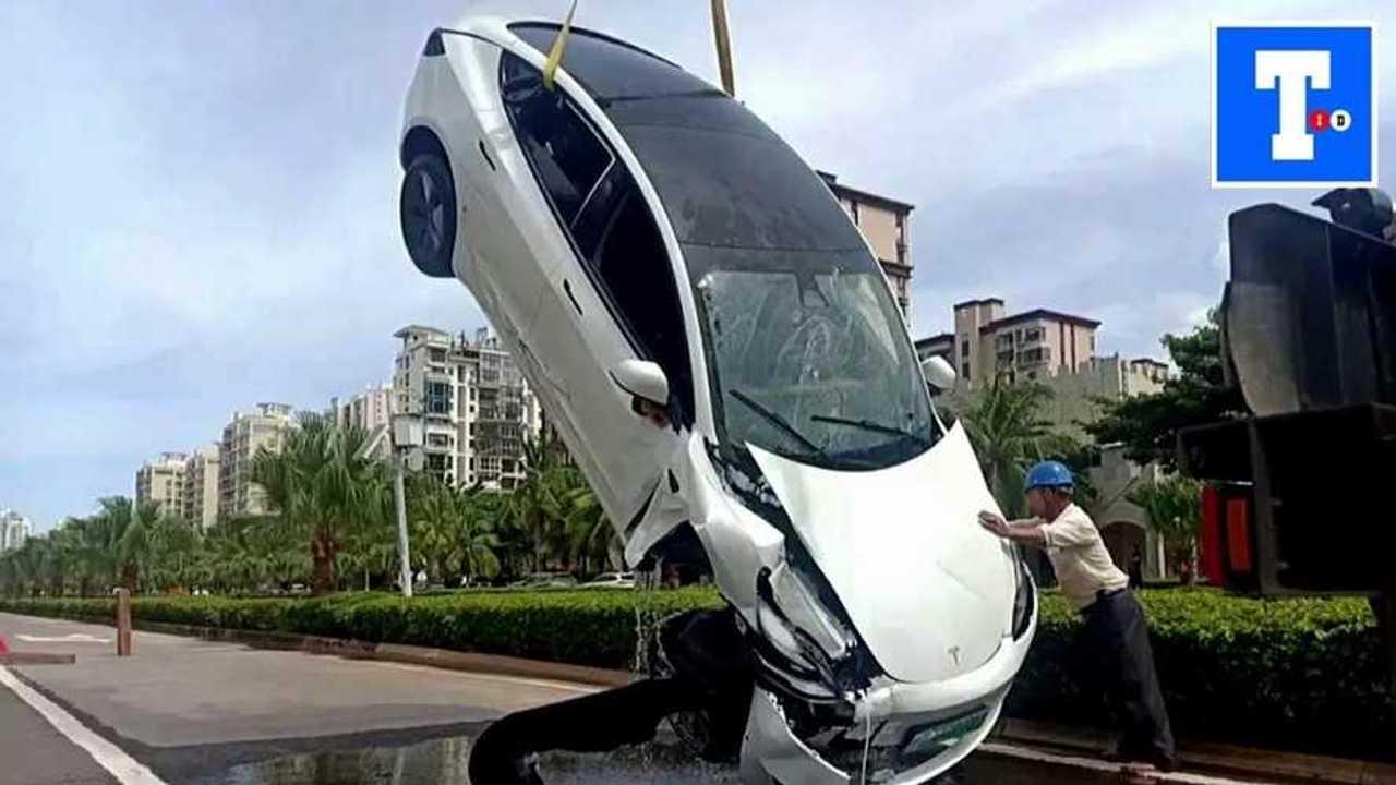 Watch Tesla Crash Through Guardrail In China, Land In A Ditch