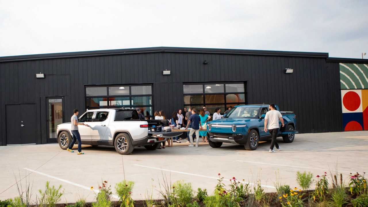 A group of preorder holders checks the Rivian R1T
