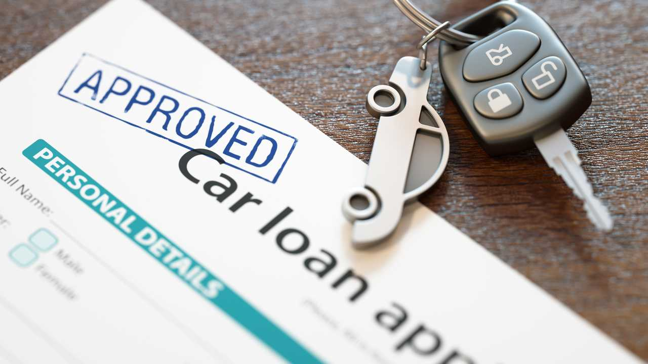 Approved car loan application with car keys