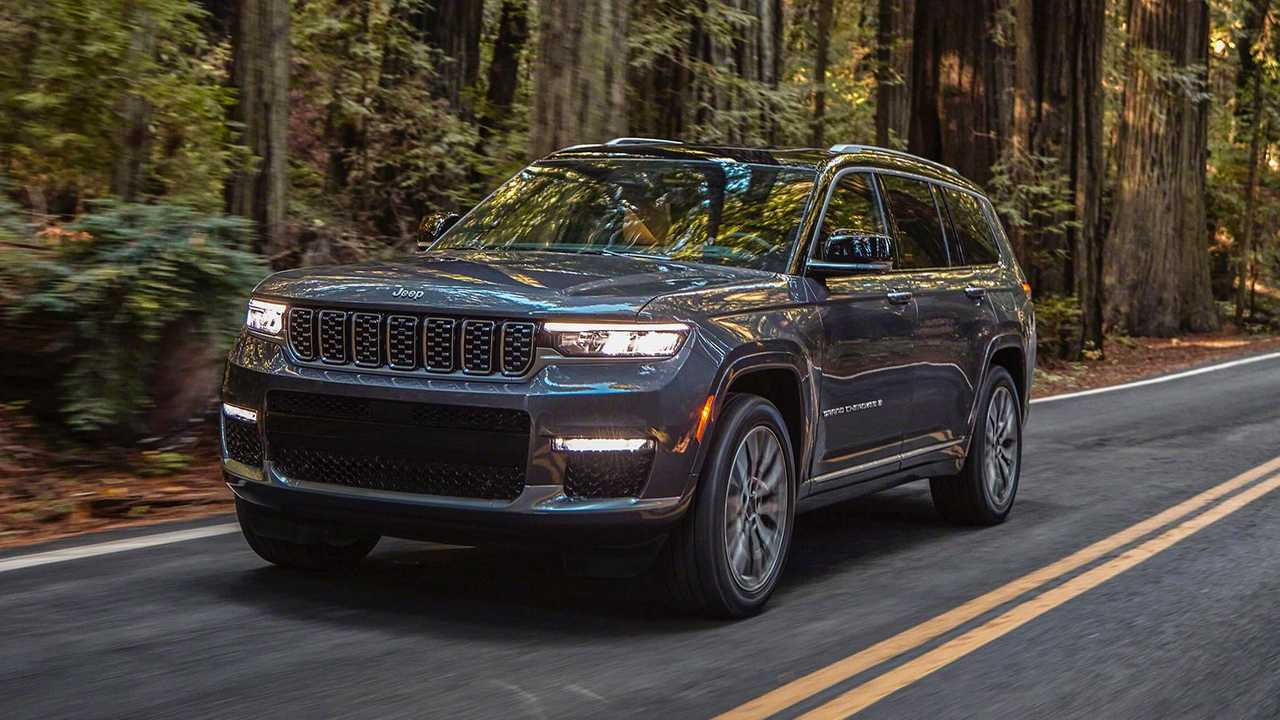 Jeep Grand Cherokee L on forest road three quarters