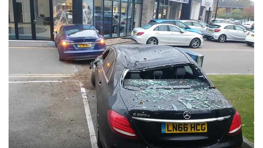 Tesla Model S Jumps Over Bushes & Car Before Smashing Into Dealership - Video