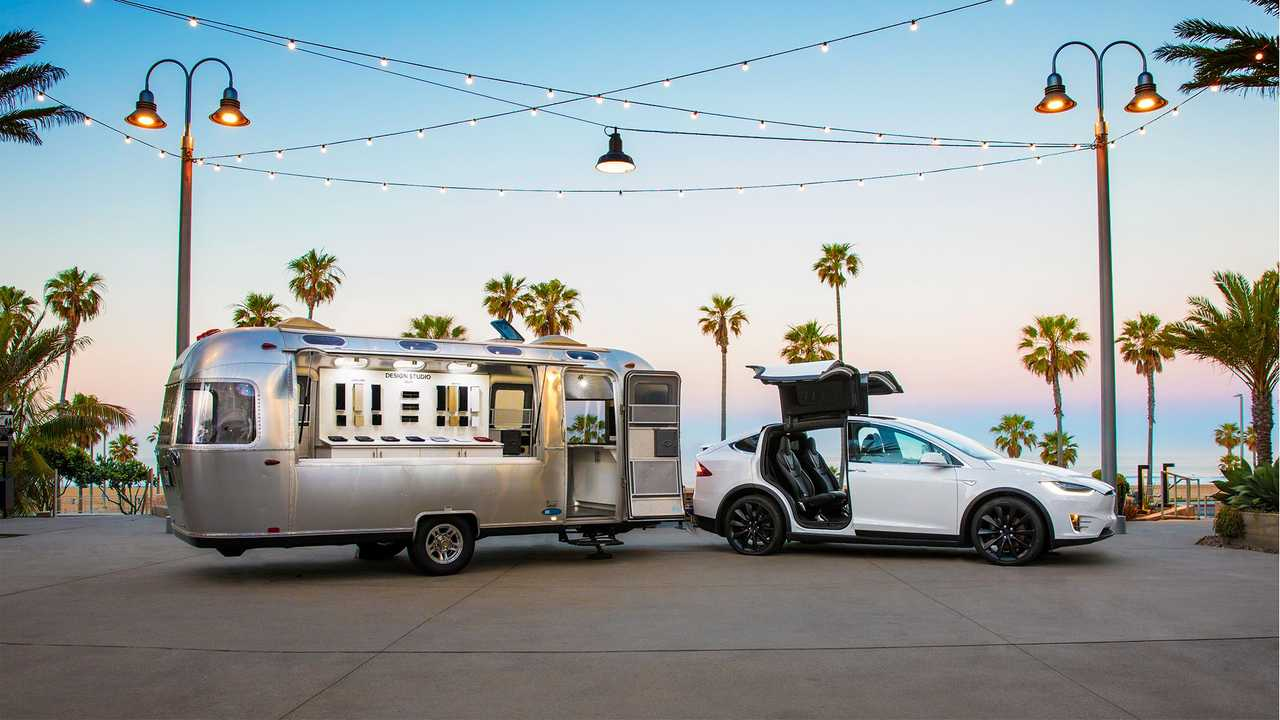 Tesla Model X and company's nomad store