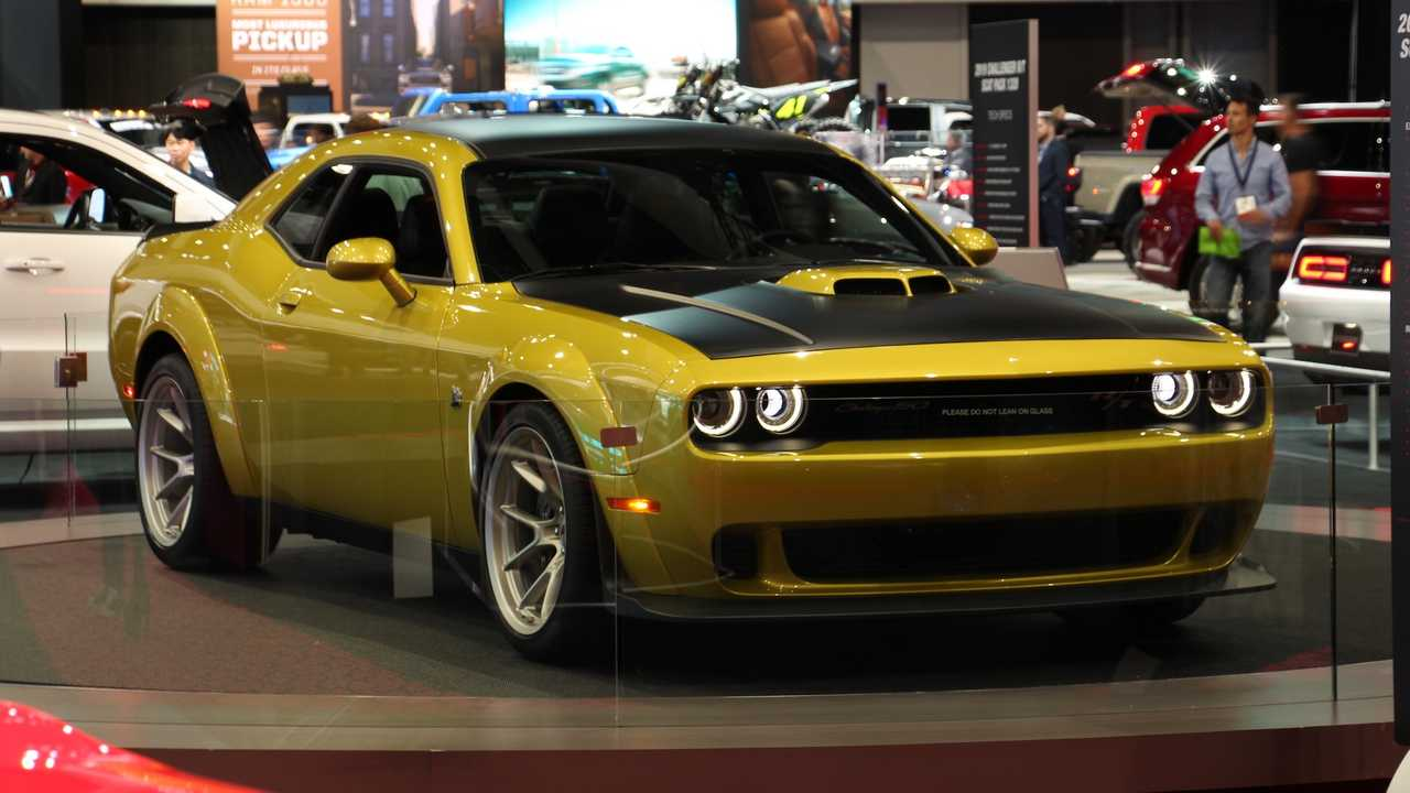 A Dodge Challenger 50th Anniversary Edition with a Gold Rush exterior.