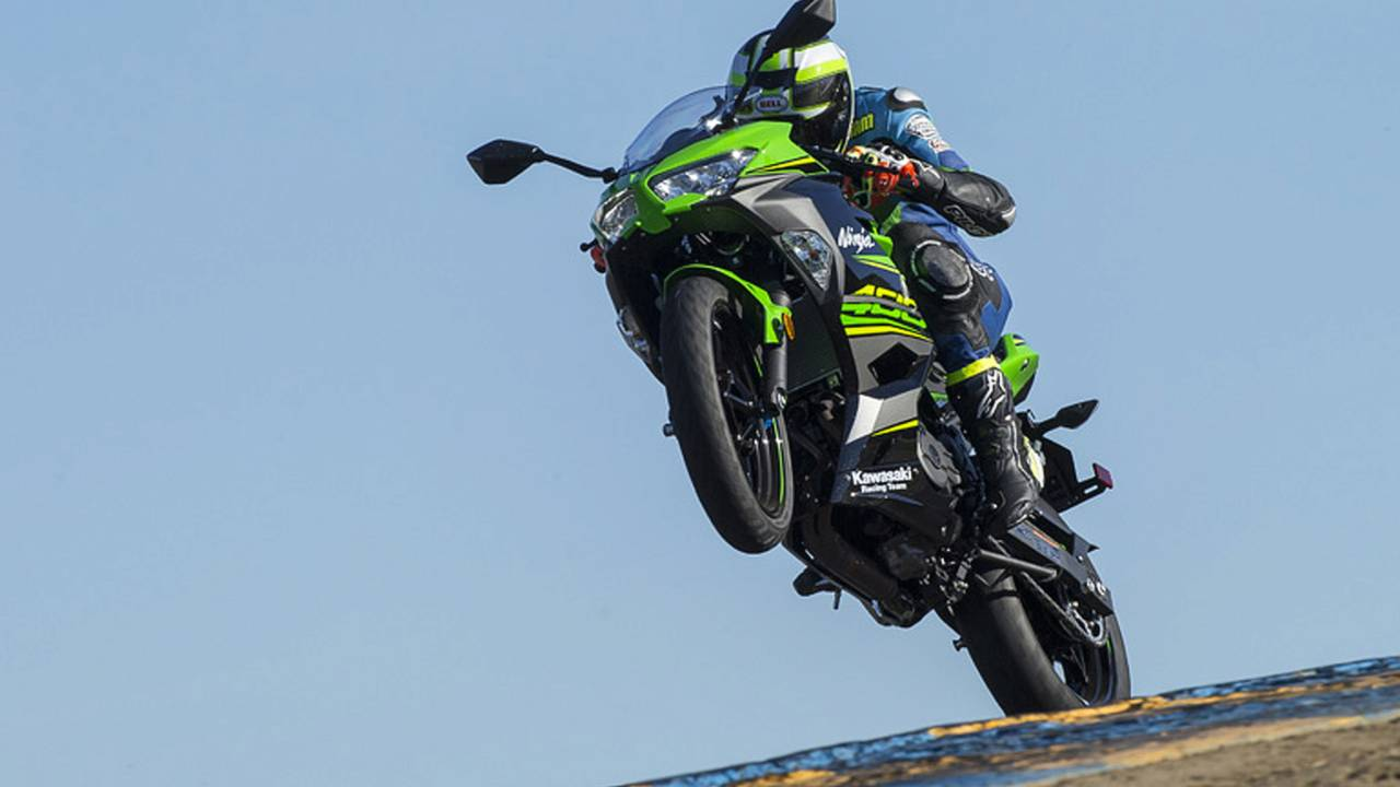 Since there weren't any on-track shots of the Ninja 400 and I, I figured I'd show off Adam's dope wheelie.