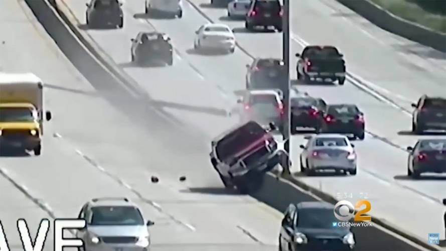 Watch A Ford Truck Take Out Several Light Poles On The Freeway