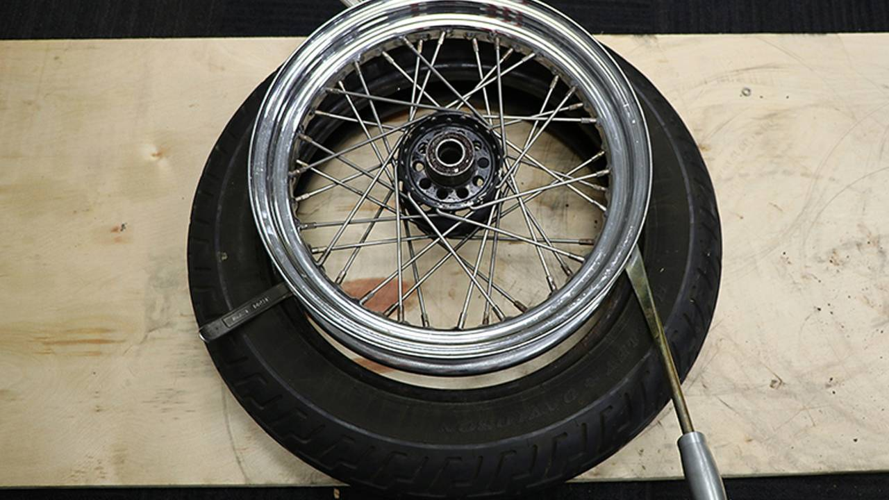 <em>At this point you should be getting the hang of the tire spoons and if you didn't invest in a long spoon you'll be regretting that decision...</em>