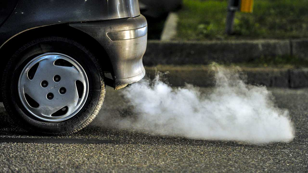 Close up of car exhaust fumes in a traffic jam