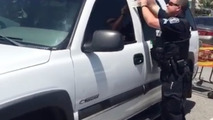 Kansas cops save puppy from sweltering car