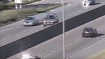 Cars get unexpected airtime driving over bump on highway