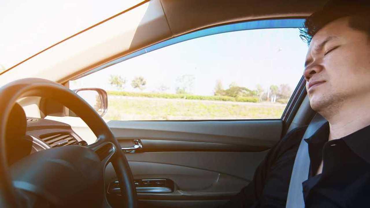Man asleep at the wheel while driving car