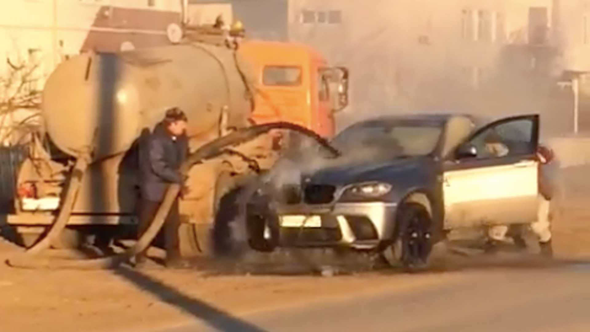 BMW Saved From Being Engulfed In Flames By Septic Truck's Poo Hose
