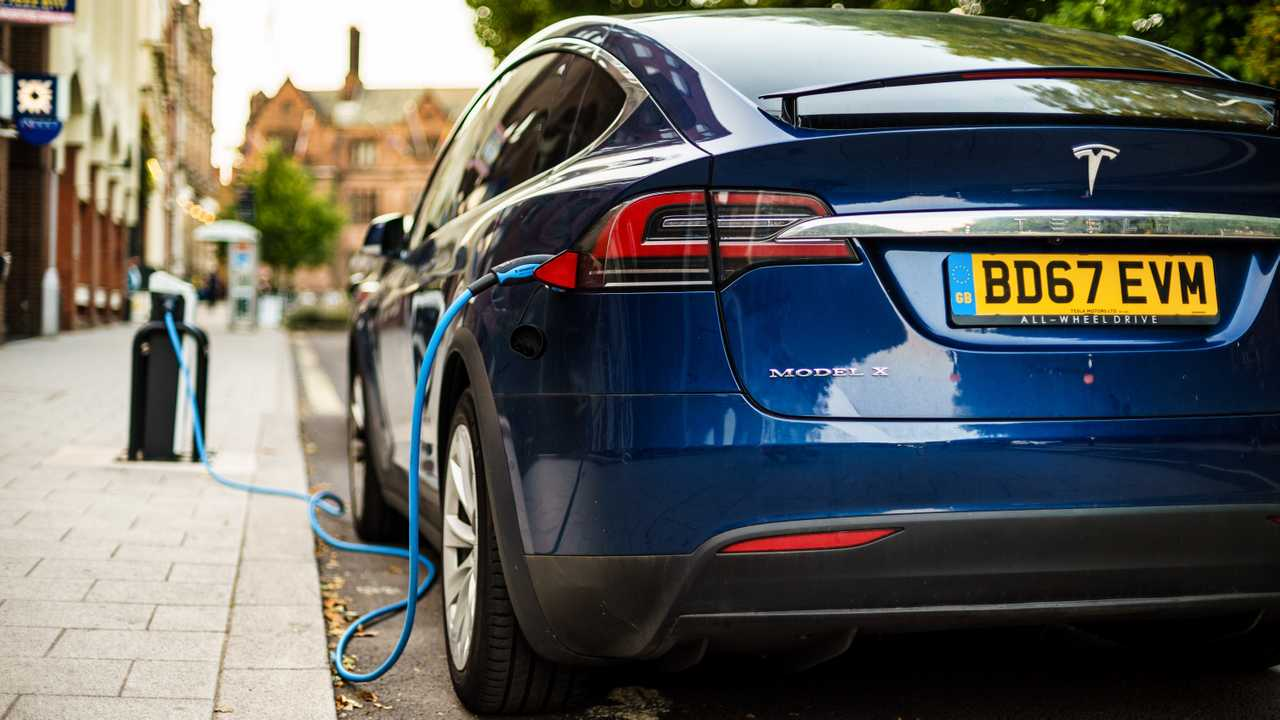 Tesla electric vehicle changing from street in Coventry City Centre
