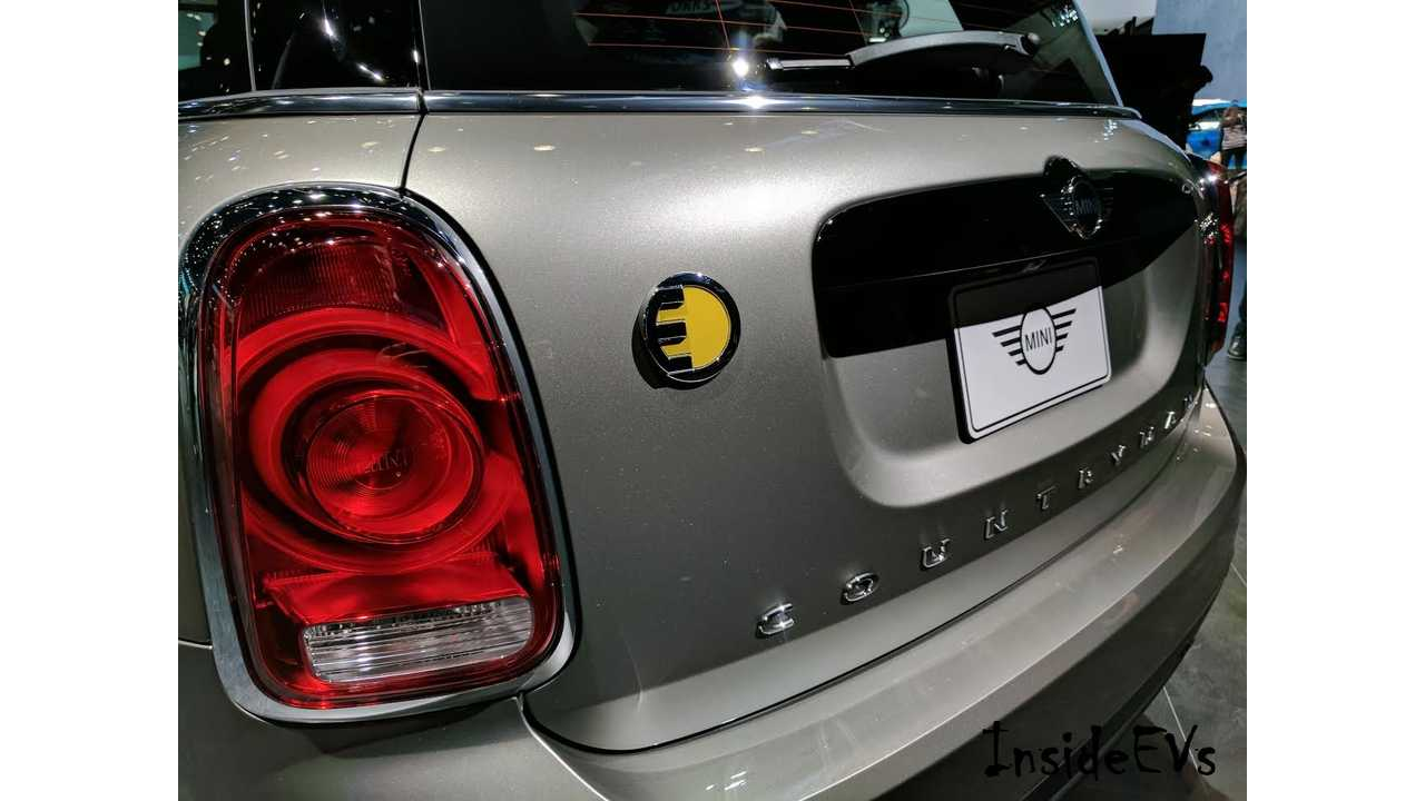 Distinctive badging lets one know this Countryman is electrified