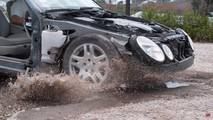 Mercedes-Benz E Class hitting pothole