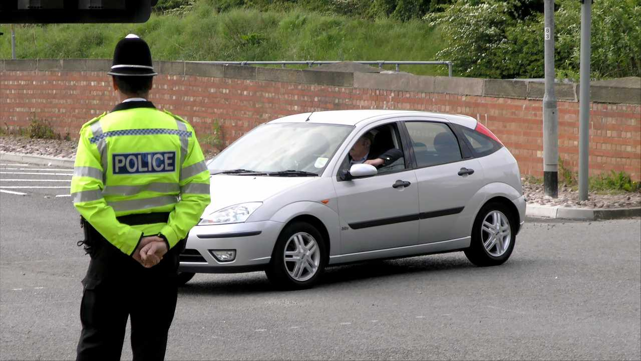 British policeman watches traffic in York UK