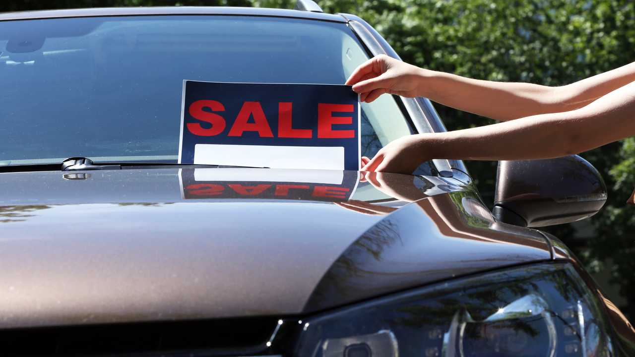 For sale sign on windscreen of car