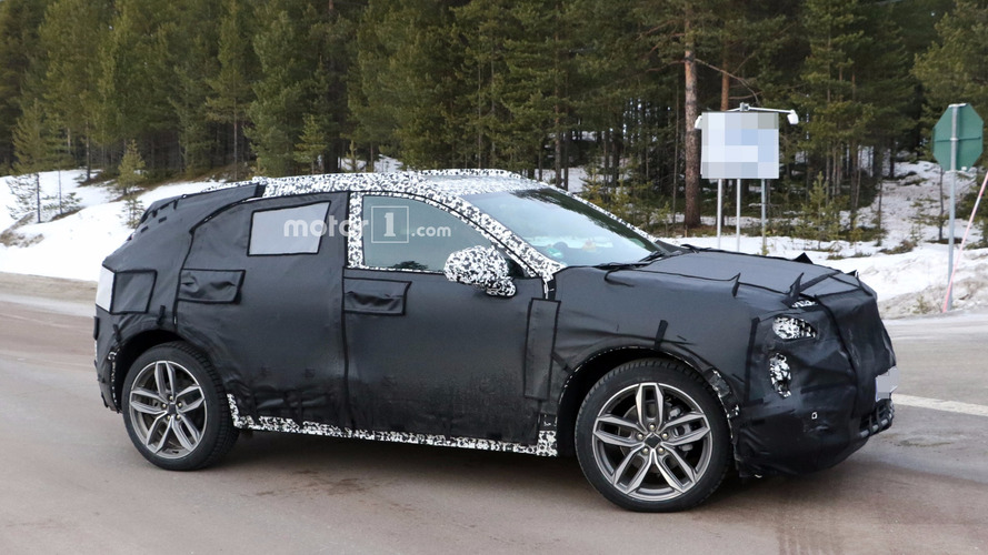 2019 Cadillac XT3 caught hiding sharp body beneath heavy camo