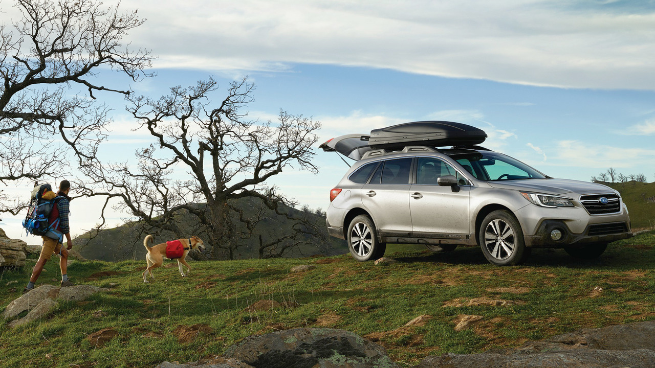2018 Subaru Outback with family and dog