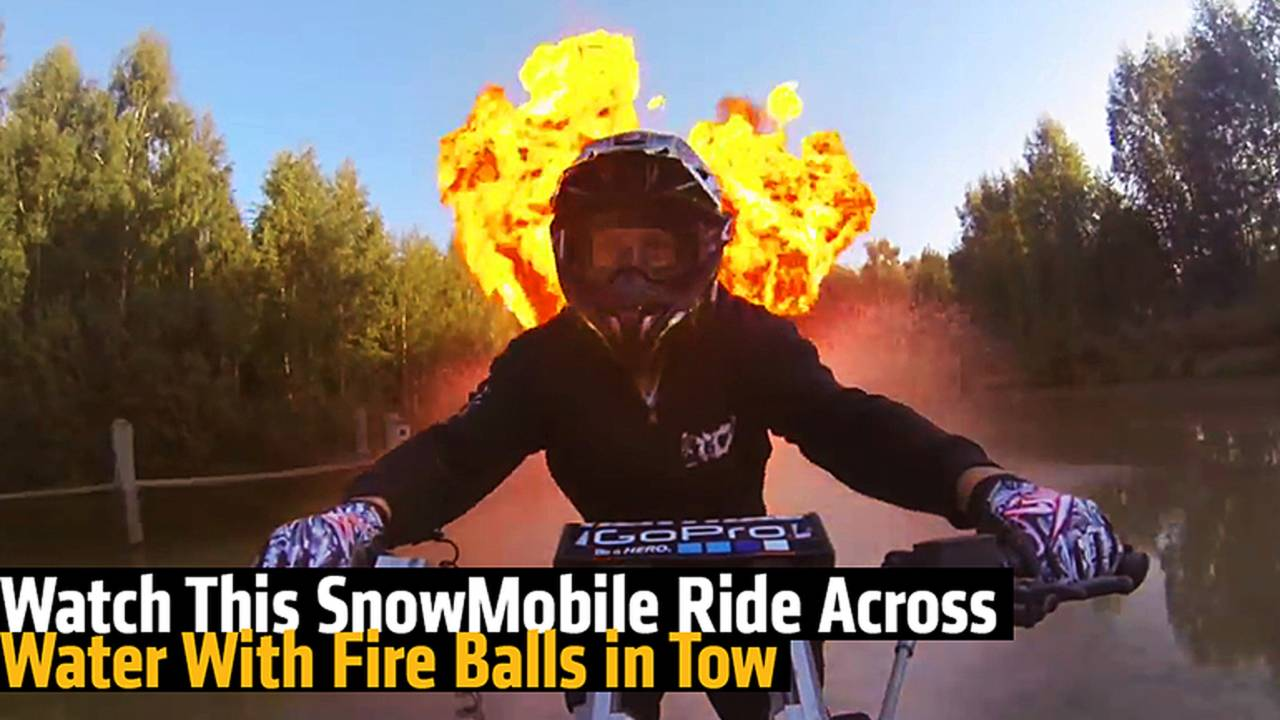 Watch This SnowMobile Ride Across Water With Fire Balls in Tow