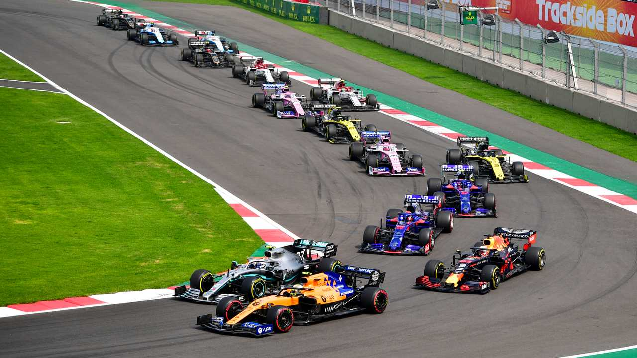 Lando Norris, McLaren MCL34, leads Valtteri Bottas, Mercedes AMG W10, Max Verstappen, Red Bull Racing RB15, Daniil Kvyat, Toro Rosso STR14, Pierre Gasly, Toro Rosso STR14, Daniel Ricciardo, Renault F1 Team R.S.19, and the remainder of the field at the start