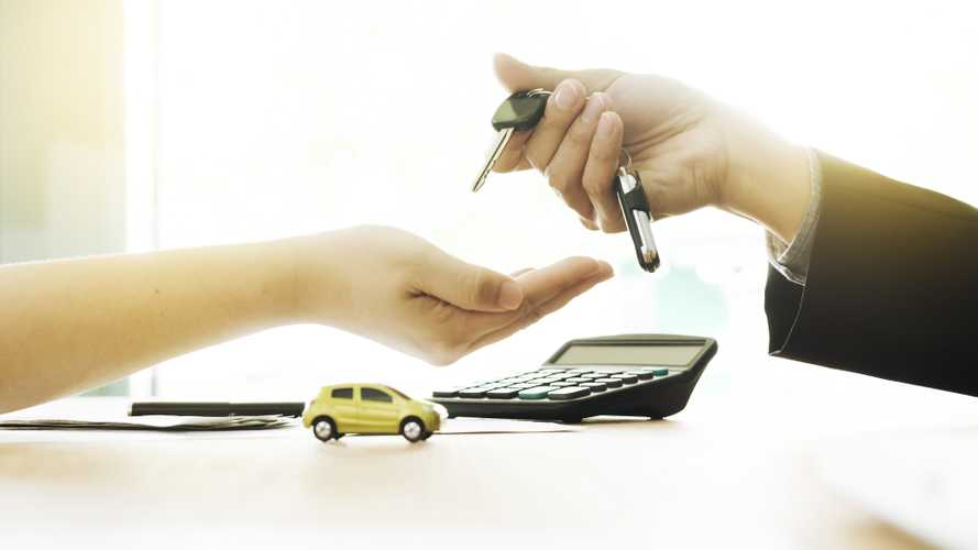 Car sales agreement with key exchanging hands
