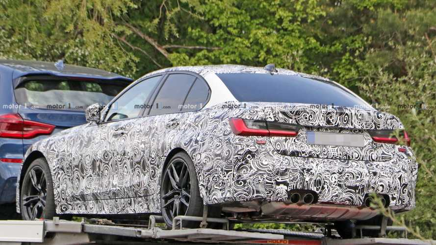 2020 BMW M3 caught on car carrier showing its undercarriage