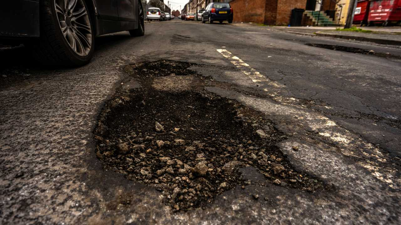 Deep pothole in road surface