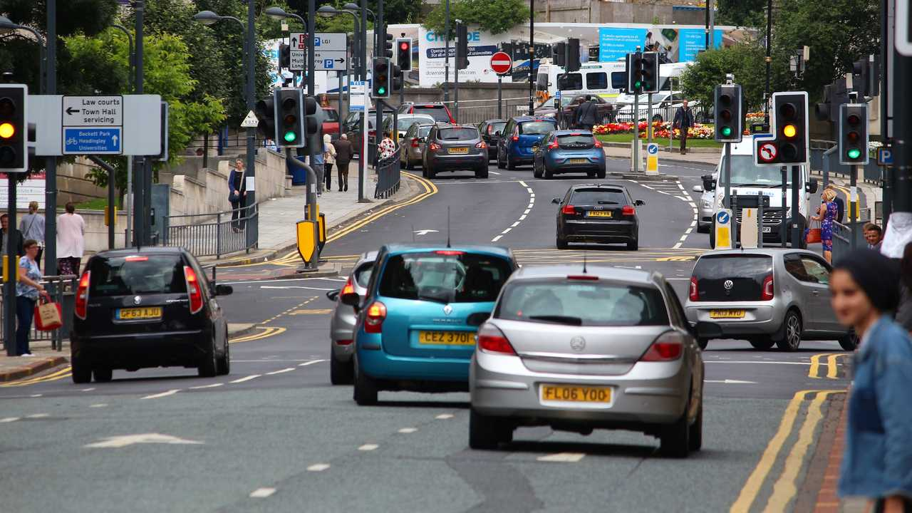 Cars driving in downtown Leeds UK