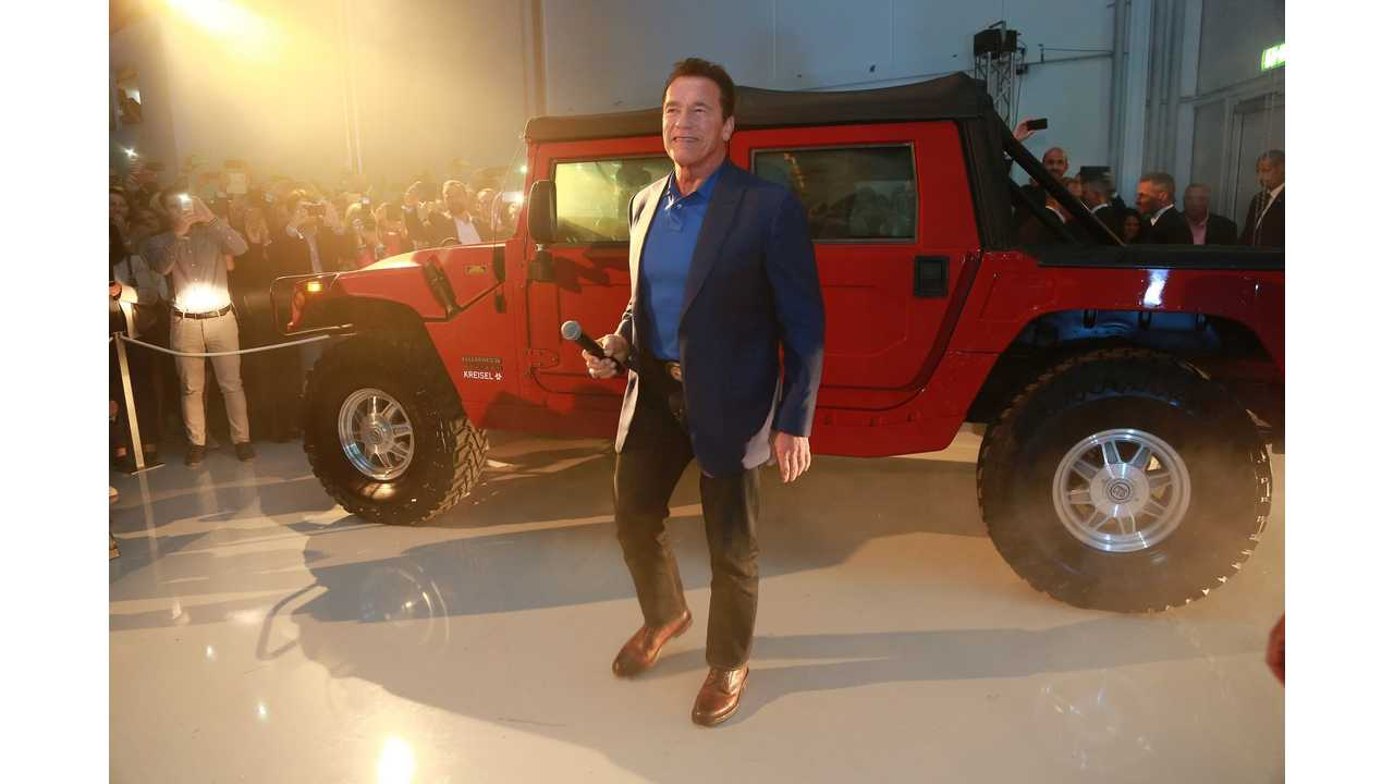Arnold Schwarzenegger in front of the world's first electrified Hummer H1 at the opening of the Kreisel Electric high-tech research and development center