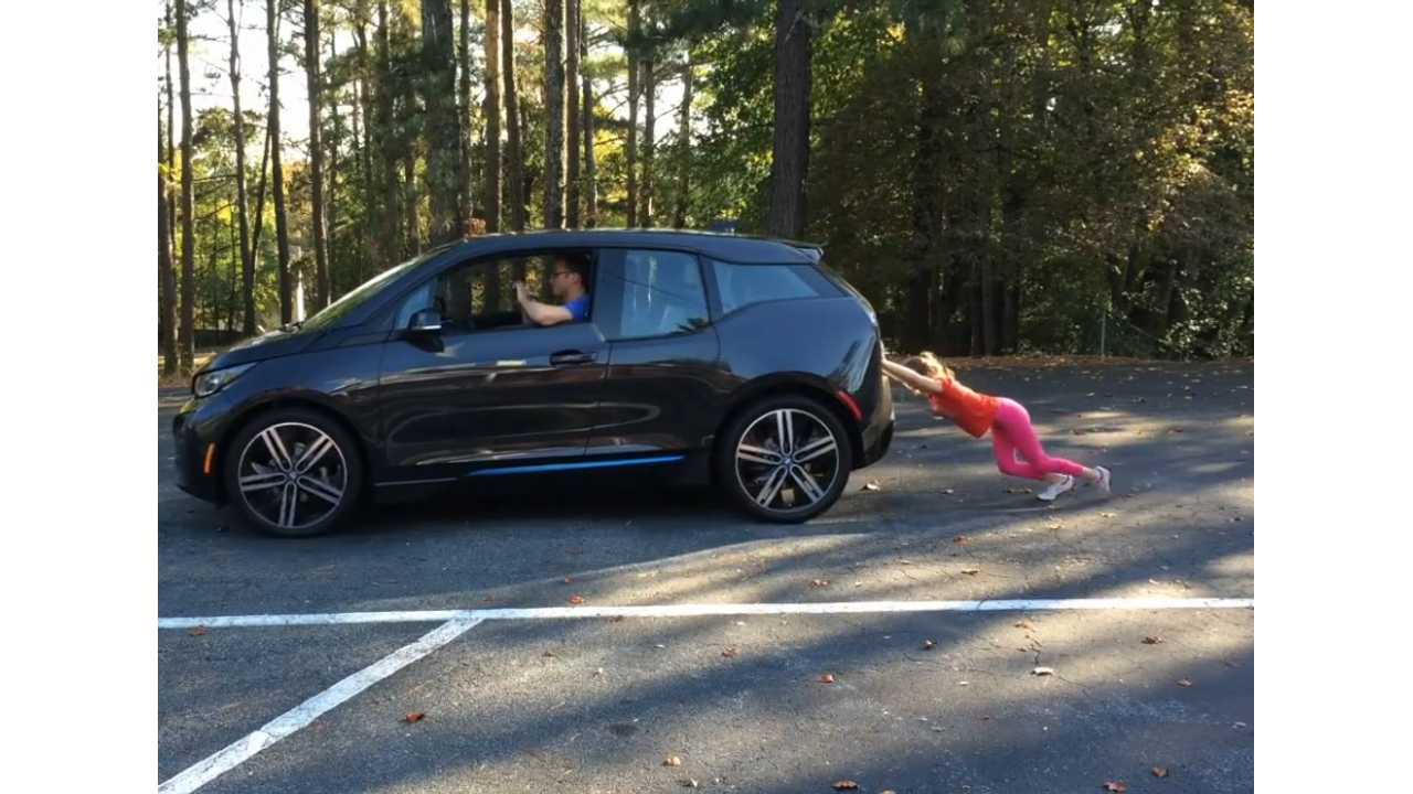 bmw i3 pushed by girl