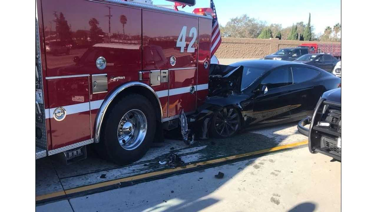Tesla Model S crashes into aparked fire truck. The driver says Tesla Autopilot was engaged. (Image Credit: Culver City firefighters via Twitter)