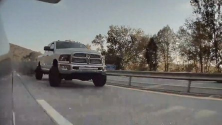 Ram Truck Tries To Coal Roll A Tesla: Watch For Ironic Window Sticker