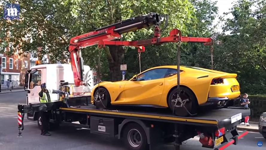 Illegally parked Ferrari gets towed from Harrods