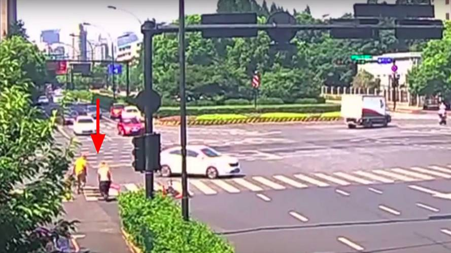 Watch a Scooter Rider Get Hit By a Car then Fall Down a Hole