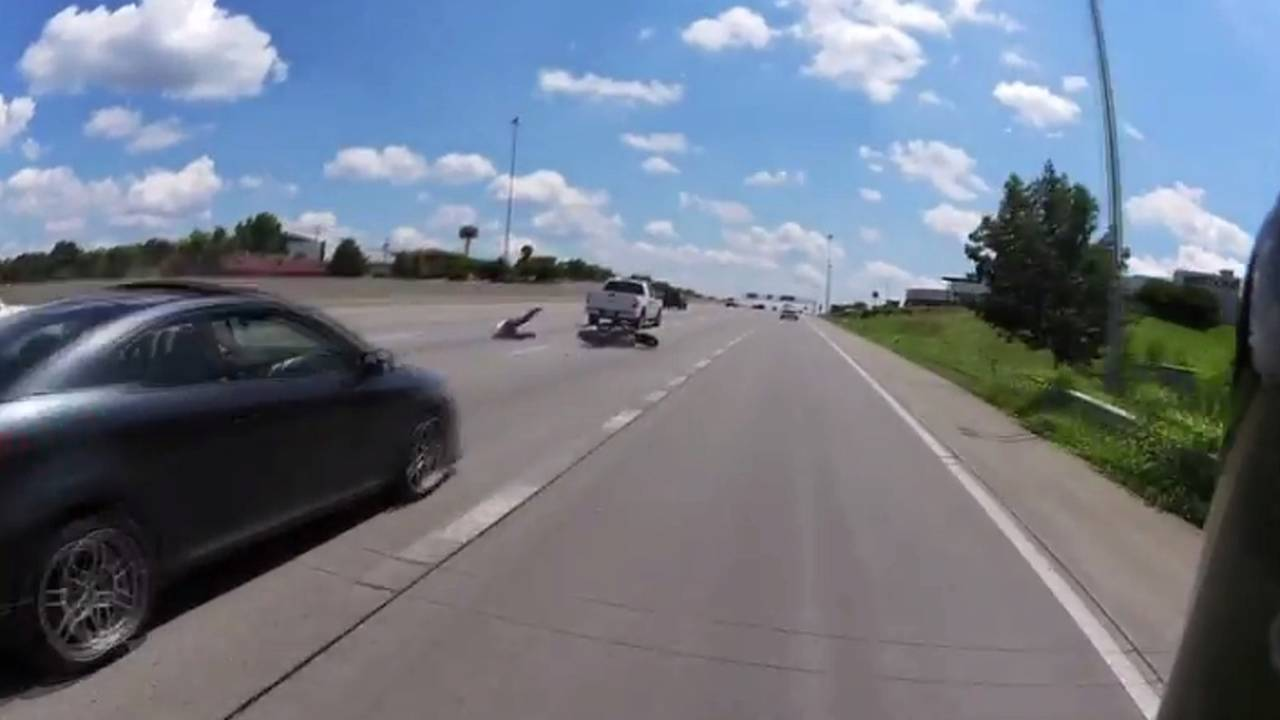 Merging Fail: Motorcyclist Collides with Truck