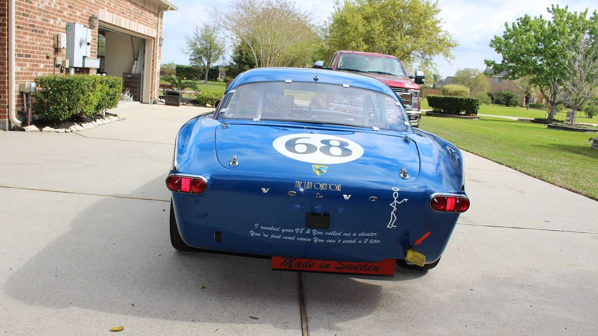 "[""Take The Checkered Flag With A Volvo P1800S Race Car And Trailer""]"