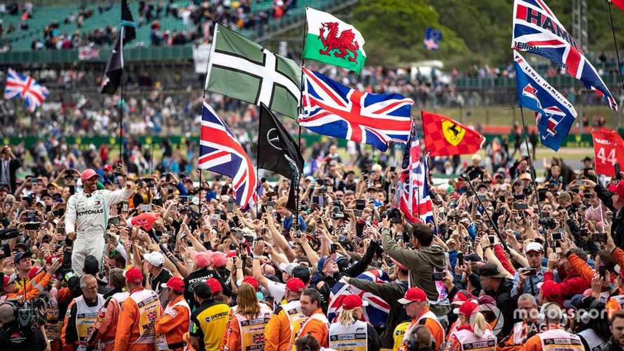Lewis Hamilton celebrates with fans at British GP 2019