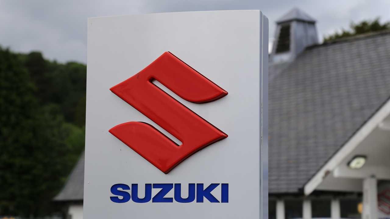 Suzuki company logo outside dealer in Dolgellau Gwynedd Wales UK