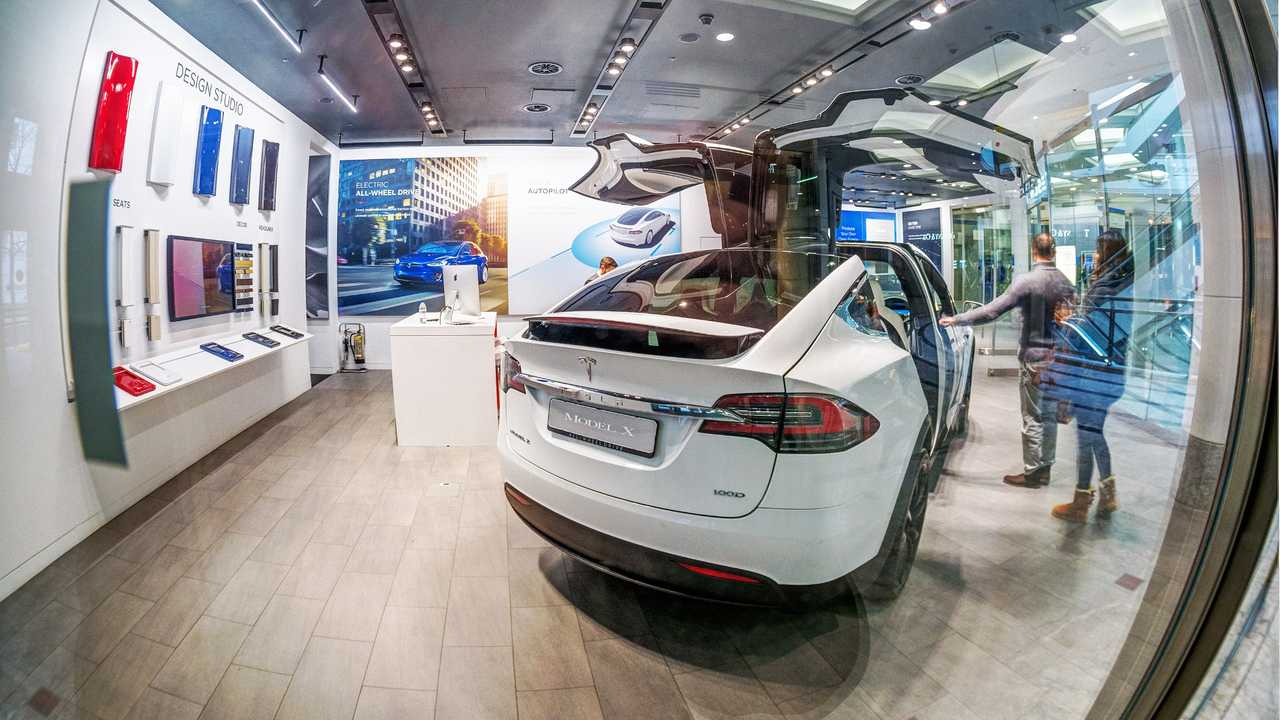 Tesla store with Model X in Cabot Square mall at Canary Wharf London UK